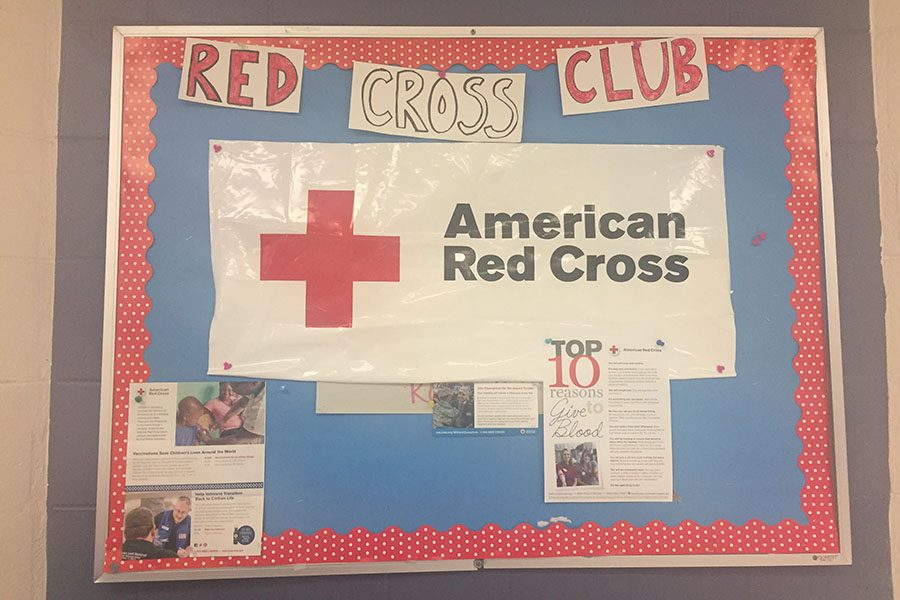 "The board outside of the lunchroom displays the Red Cross Club's upcoming events and useful information for the students. ""Our club works to help the Red Cross as much as we can, such as hosting the blood drive,"" described Sophia Whipp '20."