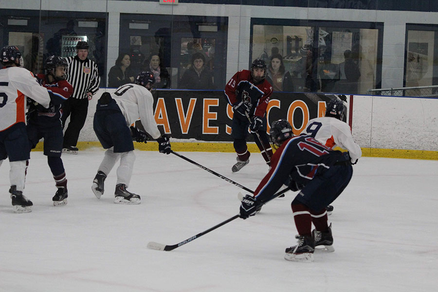 "Pictured here is Dylan Terenzoni '19 scrambling away from Conval defenders. The HBDS Warriors have seen an improvement in their play this year compared to last, which is evident with their success. ""My first three years on the team we had losing records, but this year we are currently 7-4 and tied for fourth place,"" said Terenzoni."