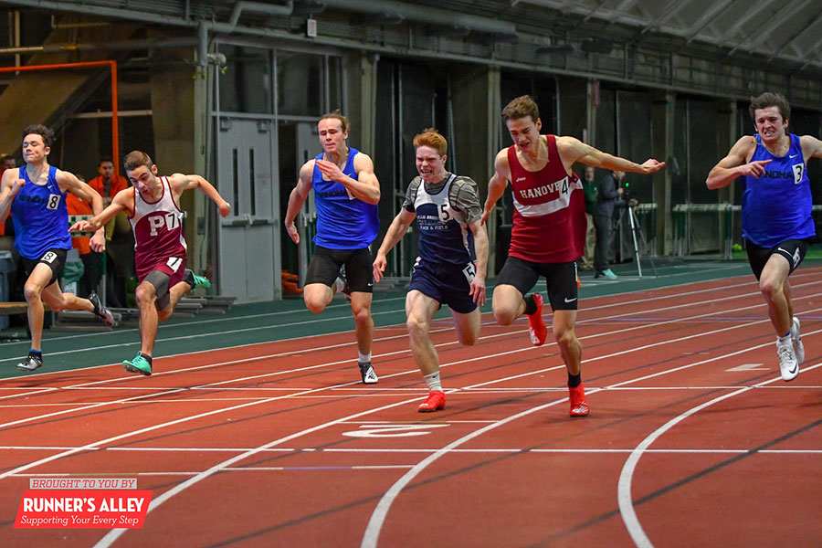 "Pictured here is junior JJ Kennedy competing in the 55m dash. Kennedy participates in the long jump, 55 meter dash, and the 4x160 relay race. Indoor track is vital to Kennedy because it ""allows [him] to stay active all winter, making me the best athlete I can be."""