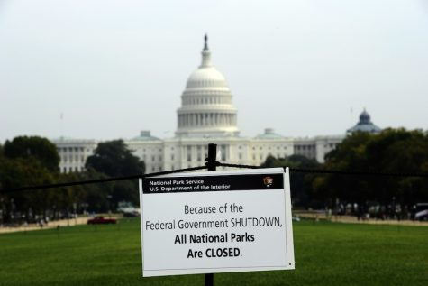 """A sign placed on the lawn on the grounds of the Capitol Building displays that all National Parks are closed due to the government shutdown. The Speaker of the House in a press release this week said that """"Families across the nation are still trying to recover from a month of missing paychecks and overdue bills."""""""