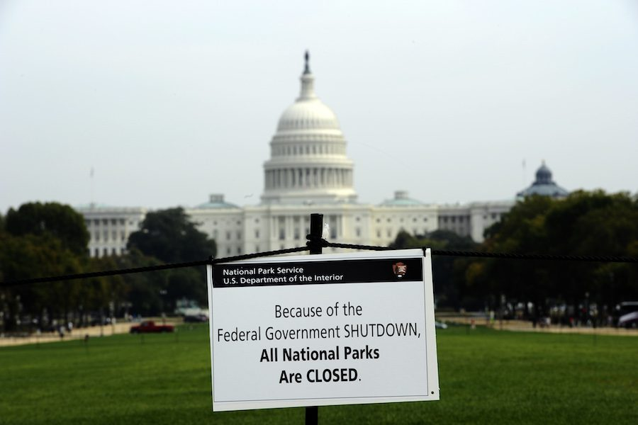 "A sign placed on the lawn on the grounds of the Capitol Building displays that all National Parks are closed due to the government shutdown. The Speaker of the House in a press release this week said that ""Families across the nation are still trying to recover from a month of missing paychecks and overdue bills."""