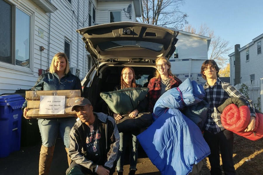"Pictured are a few members of HB the Change, Tess Crooks, Johanna Golden, and Lorenzo Occhialini, helping out in the community. HB is giving donations to the less fortunate in the homeless stage. ""I think that all of us made an impact on at least one person's lives,"" said Maddie Norris '19."