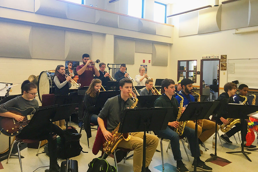 "The Hollis Brookline High School Honors Jazz Band is playing as a whole ensemble. They were one of the 11 bands which attended the NHBDA Jazz Clinic. ""It's very nice to have probably some of the best musicians in the region help give you a lesson,"" said Jack Sinclair '19.   From left to right: Front row: Cayden Plummer '21, Zach Sommer '21, Dhruv Miglani '19, Anderson Steckler '20, Spencer Murray '21. Second row: Katie Hinchliffe '19,  Caroline Pack '19, Jack Sinclair '19, Dan Aulbach '21, Lily Jackson '20. Third Row: Amy Norton '19, Mike Moscatelli '19, Caleb Clark '20, Justin Surette '21, Julia Pepin '19."