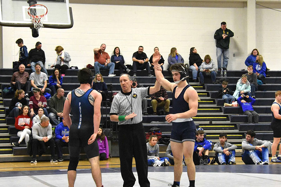 """After retiring from gymnastics his freshman year, Scott Anneser '19 made the transition to wrestling. Just two years after picking up the sport, he is now one of the top wrestlers in the state. """"It's a long and tough season, but it's all worth it to get your hand raised at the end of a match,"""" said Anneser."""