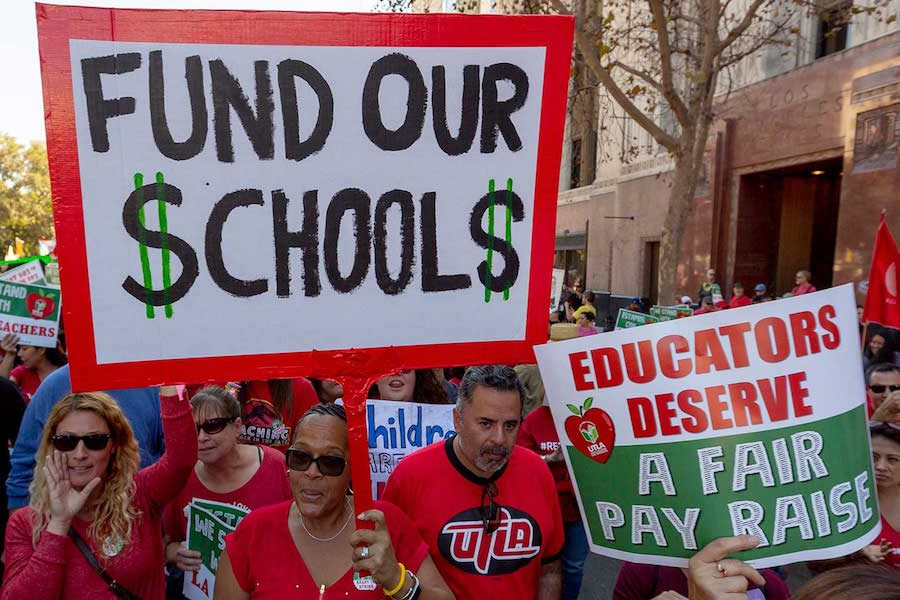 Teachers march the streets of downtown Los Angeles, striking for better pay and working conditions. Both educators and parents alike hold signs in protest. As the strikes continue, the UTLA President, Alex Caputo-Pearl spoke, saying,