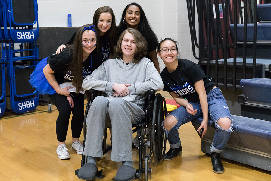 Niko Martin is photographed with (from left to right) Sofia Barassi'19, Gabby Paquin'19, Khishi Patel'19 and Tess Crooks'19 during their Spirit Week assembly in February