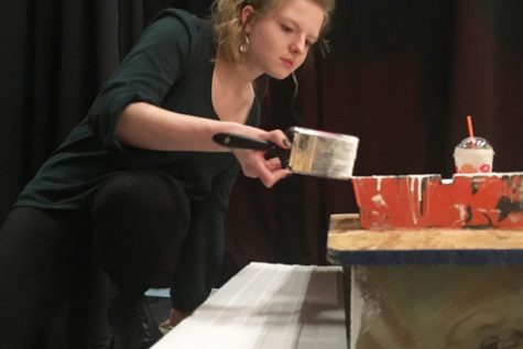 Stage manager Caroline Pack '19 paints steps for the set of Mamma Mia.