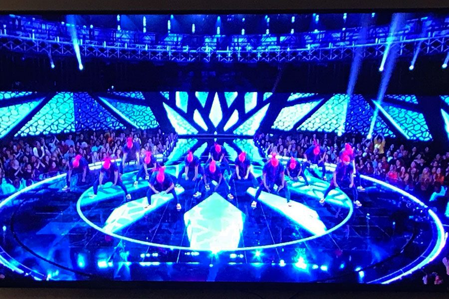 The+Kings%2C+a+hip+hop+group+in+the+Upper+Team+division%2C+performs+for+the+judges.+In+this+routine%2C+they+shocked+the+audience+with+their+routine%2C+and+showed+off+their+challenging+stunts.+Jennifer+Lopez%2C+one+of+the+judges%2C+was+mind+blown+by+this+group%2C+saying+that+she+was+%E2%80%9Cshook+to+the+core%E2%80%9D+by+their+performance.