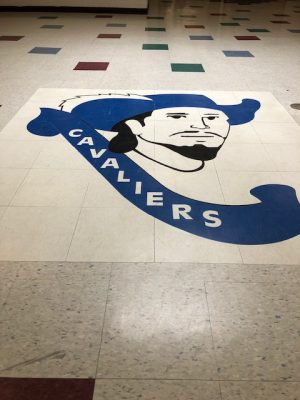 The Cavalier mascot logo on the floor of the back lobby.