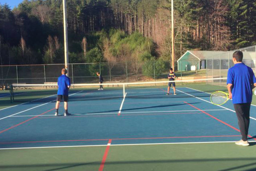 "Rory Klauber (left) and Will Pesiridis (right) competed in doubles against Conval this past Wednesday. ""This was the only loss during the match,"" said Pesiridis '21, but it didn't pose a threat to the team as they ended with an 8-1 win. The boys' next game is against Goffstown on their home court!"