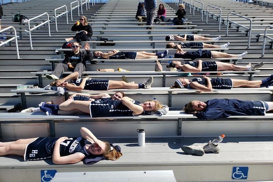 "Pictured here is the girls varsity lacrosse team laying on the bleachers in an attempt to tan between games. ""It was actually kind of nice,"" says White. ""Well, until we realized what happened. That just hurt."""