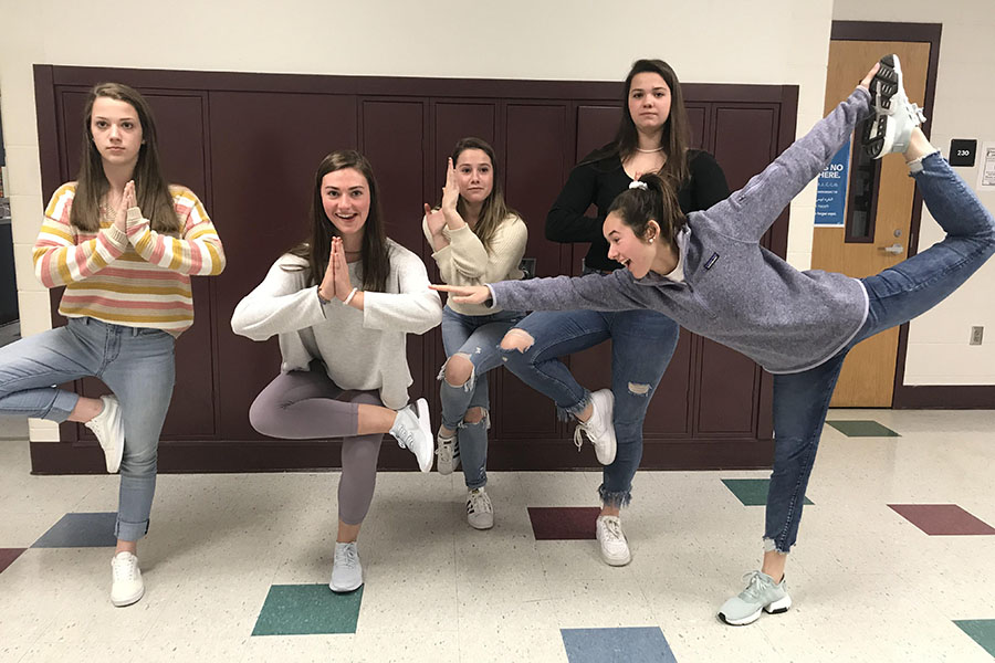 "Peyton O'Connor, Jessica Hubert, Meredith Yardley, Tasha White, and Teresa DeMaio, all from the junior class, strike a pose in the halls. Yoga is an enjoyable activity to do with your friends. ""Yoga is a way of life,"" said O'Connor '20."