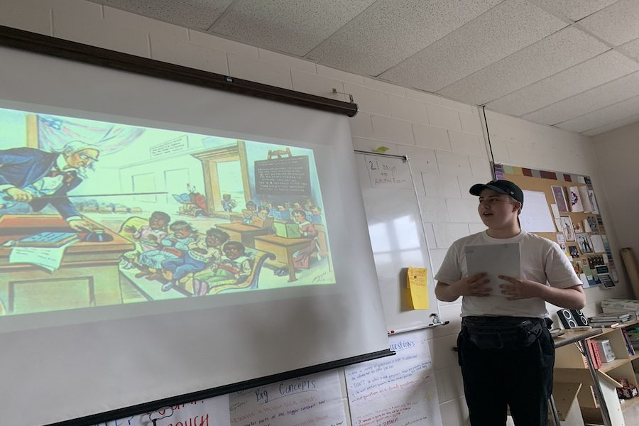 Ian McNabb '20 leads a class discussion on political cartoons from the American Progressive-Era. Visibly honored to hold a leadership role, McNabb references Captain Philips by stating,