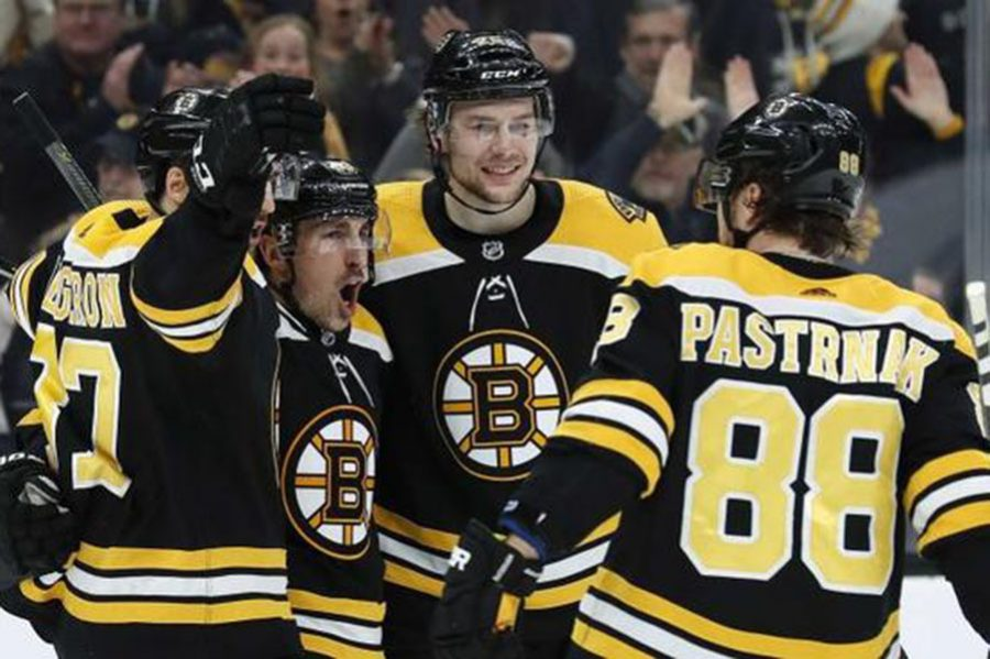 Patrice+Bergeron%2C+Brad+Marchand%2C+Torey+Krug%2C+and+David+Pastranak+%28left+to+right%29+celebrate+their+goal.+%E2%80%9CI+love+you+all+my+brothers...4+more+wins+is+our+goal%2C%E2%80%9D+Marchand+says+in+his+Instagram+caption+after+game+four+against+the+California+Hurricanes.+The+team+is+ready+to+give+it+everything+they+got+to+earn+the+title+Champions.
