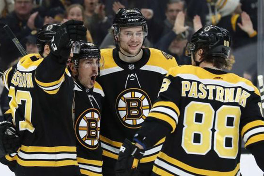 """Patrice Bergeron, Brad Marchand, Torey Krug, and David Pastranak (left to right) celebrate their goal. """"I love you all my brothers...4 more wins is our goal,"""" Marchand says in his Instagram caption after game four against the California Hurricanes. The team is ready to give it everything they got to earn the title Champions."""