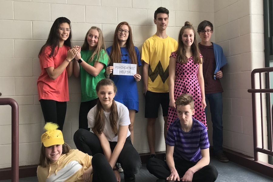 Left to right: Freshmen Lara Coady '22, Hallie Bardani '22, Maggie Crooks '22, Miles Montgomery '22, Emma Harley '22, Jeremy King '22, Noah Sinclair '22, Claudia Pack '22, and Anna Musteada '22 having fun during Spirit Week. Note the smiles on their faces. These are sure to vanish by the time they become upperclassmen.