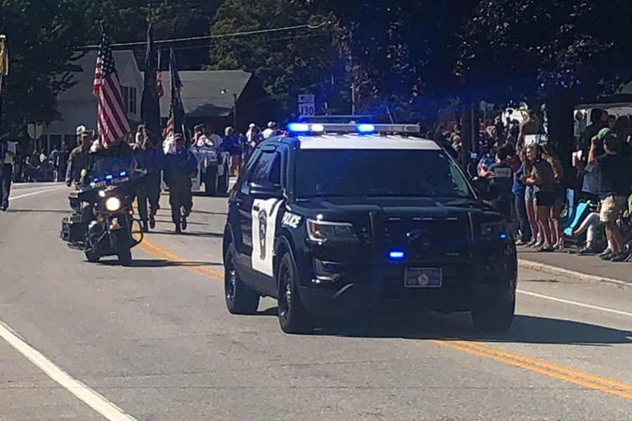 "Brookline Police cruisers lead the parade with flashing lights. Brookline held it's anticipated 250th parade on Sept. 21. ""This parade will be the biggest parade I have ever seen in my life,"" said Cindy Gorgiglione."