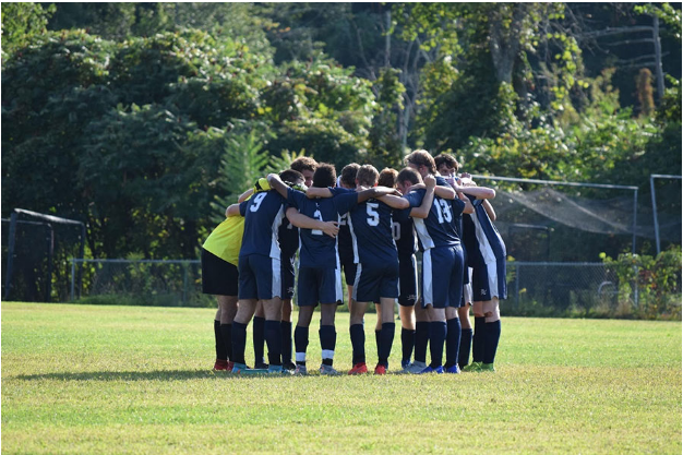 "The boys huddle up together before their match. The team is currently 9-5-1 as they begin to wrap up their regular season. ""I feel like we have grown both as players and brothers,"" said Ethan Smith '21."