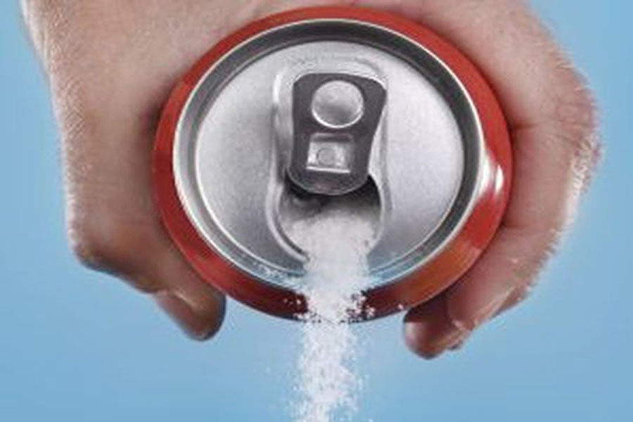 A person is pouring out a soda, but instead of liquid, aspartame is falling out of the can, the same color and consistency as sugar. This shows that people do not know the dangers of aspartame because they cannot see a difference between aspartame and regular sugar.