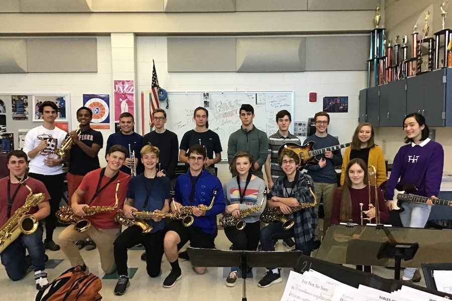 Members+of+the+Honors+Jazz+Band+pose+with+their+instruments+at+the+end+of+rehearsal.+The+Honors+Jazz+Band+plays+everyday+during+Period+4.+%E2%80%9CHBHS+would+be+at+a+serious+disadvantage+if+they+deprived+their+students+of+a+music+program%2C%E2%80%9D+said+Mary+Martin+%E2%80%9820.