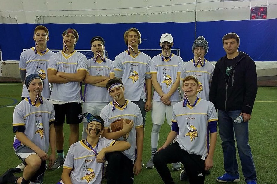 """A Hollis Brookline flag football team celebrates their third consecutive championship in the Hampshire Dome Flag Football league. Hollis Brookline teams have consistently dominated this league since 2015, always winning their respective divisions. """"Flag football is very big at Hollis Brookline, it almost feels like a dynasty,"""" said Brian Holroyd."""