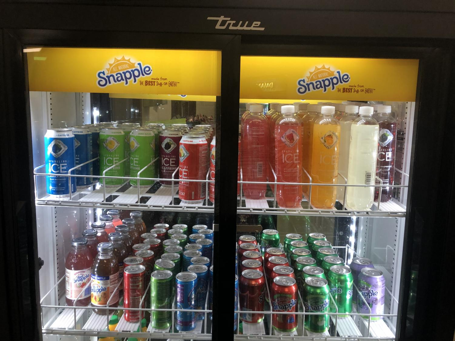 """The new beverages are lined up on the racks of the fridge. These drinks will probably be sold out by third lunch! """"I love the new drinks!"""" said Logan Desruisseau '22."""