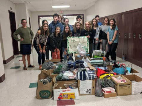 """The HB the change group stands behind their chemo care packages made for Pink Revolution. The group spend a tuesday afternoon counting and boxing donations. """"It's a great group that does acts of kindness for people,"""" said Samantha Messina '21."""