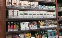 """Local convenience stores are packed with various vape and tobacco products. Stores all around the state have put up signs to detail the legal age change, which will hopefully result in less underage people having access to the products. """"I feel like younger kids that do it only do it to look cool, but people who started it to look cool definitely have a problem,"""" said a group of HB students."""
