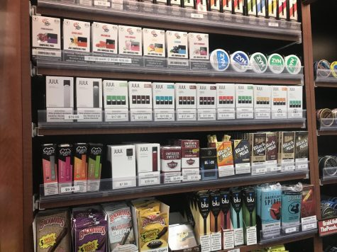 "Local convenience stores are packed with various vape and tobacco products. Stores all around the state have put up signs to detail the legal age change, which will hopefully result in less underage people having access to the products. ""I feel like younger kids that do it only do it to look cool, but people who started it to look cool definitely have a problem,"" said a group of HB students."
