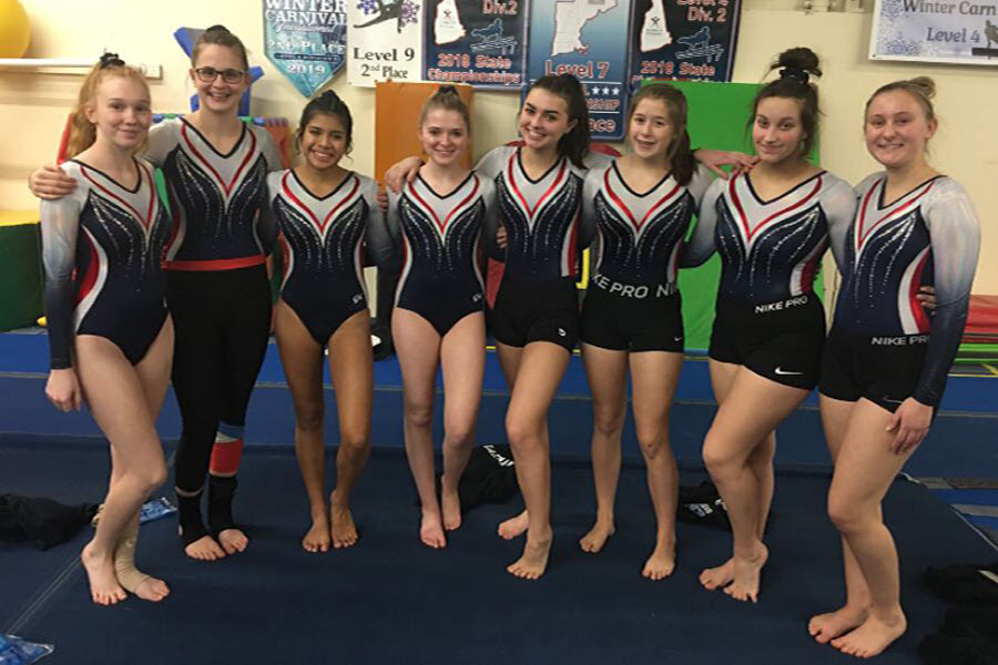 "Gymnastics team members after competing at their second meet of the season. ""Taking second place compared to placing fourth in our last meet is evidence of improvement so early on in the season,'' said Lindsey DeJoie '22."