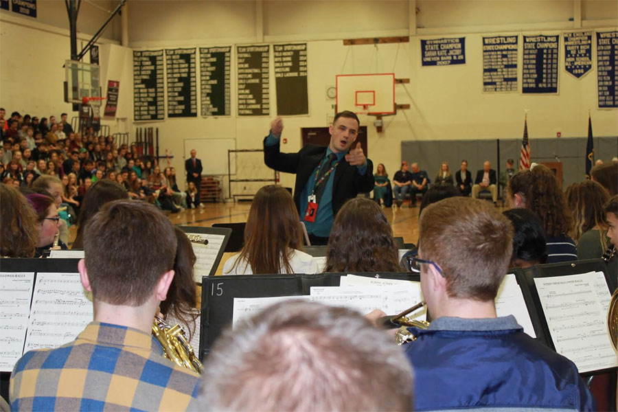 The+new+band+teacher%2C+Charles+Rogers%2C+is+conducting+the+concert+band+during+the+Veterans+Day+assembly.+Although+he+just+began+teaching+at+H.B.H.S.%2C+many+of+the+students+seem+to+enjoy+his+teaching+style.%0A%E2%80%9CI+really+like+the+songs+he+chooses+and+the+way+he+tries+to+conduct+the+songs%2C%E2%80%9D+said+Rachel+Brackett+%E2%80%9822.