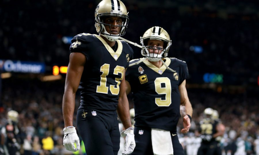 NEW ORLEANS, LOUISIANA - JANUARY 13:  Michael Thomas #13 and Drew Brees #9 of the New Orleans Saints celebrate their third quarter touchdown against the Philadelphia Eagles in the NFC Divisional Playoff Game at Mercedes Benz Superdome on January 13, 2019 in New Orleans, Louisiana. (Photo by Sean Gardner/Getty Images)