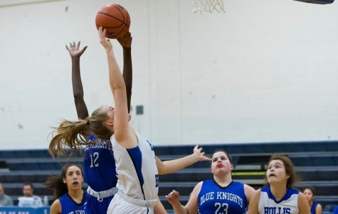 "Amanda Goclowski '20 goes up for a basket during a 2019 game. This is Goclowki's third year on the varsity team. ""Currently, we have a record of 13-1. We beat Lebanon and that game we came out ready to play, the adrenaline that game was immense,"" said Goclowski."