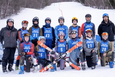 "The HB skiers pose for a group picture after a race. The HB ski team practiced and raced at Crotched Mountain throughout the season, where they had a strong performance at their state meets.  ""It was a great group of kids. It was a fun experience every time I went,"" said Assistant Coach Milton Robinson."
