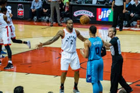 "Kawhi Leonard defends the inbound pass as he leads his team to victory. The All Star game didn't fail to disappoint as the new rules entertained all around the world, ""I think that the 4th quarter of this All Star game was one of the most  competitive I've seen in my life,"" said Joey Oetjens '21."