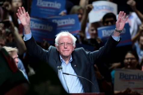 Vermont Senator Bernie Sanders raises his arms in victory following the New Hampshire Primaries. Sanders edged out his top opponent Pete Buttigieg, accruing 26% of the Democratic vote. According to  WMUR, Sanders addressed supporters following his victory.
