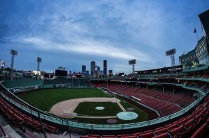 "Caption: The sun rising at the empty Fenway Park, the morning of Apr. 2. It was supposed to be the Red Sox Home Opener, which has now been postponed indefinitely. ""Despite no baseball, the Opening Day sunrise photo must live on,"" said Billie Weiss, Red Sox photographer."