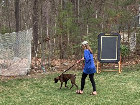 "Brooke Allanach '21 walks her dog to get some fresh air and exercise in quarantine. She has been enjoying spending as much time outside as possible to keep busy and remain active daily. ""It's a good way to let some of the longer days go by a bit faster."""