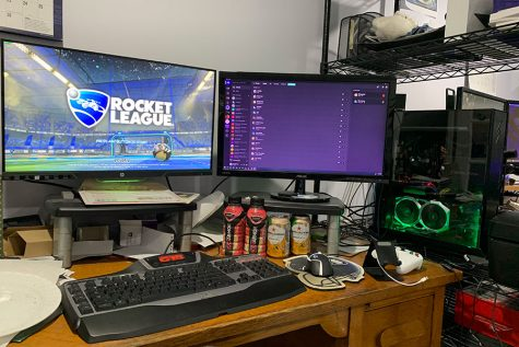 "Aaron Lawrence shows off his extravagant gaming setup before digging into his daily dose of Rocket League. Though Aaron participates in many different online games, Rocket League has been a mainstay for him since he bought it. ""I assume most people are cranking up the gaming time right now,"" said Lawrence."