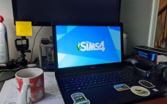 "Hannah Escandon loads up the Sims 4 on her laptop, as she cracks her knuckles in anticipation of the intense gaming session to follow. ""I like building things in the sims because you can just have all the money in the world, and like wow!"""