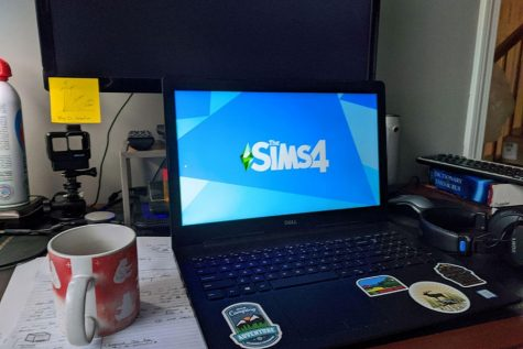 """Hannah Escandon loads up the Sims 4 on her laptop, as she cracks her knuckles in anticipation of the intense gaming session to follow. """"I like building things in the sims because you can just have all the money in the world, and like wow!"""""""