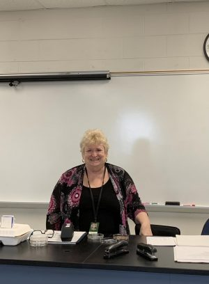 "While getting materials ready for today's AP Environmental Science class, Mrs. Brooks briefly removes her mask for a quick smiling photo. ""Really the joy of my life is teaching science,"" said Brooks."