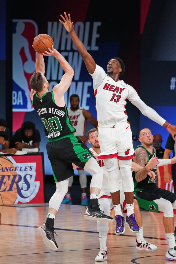 ORLANDO, FL - SEPTEMBER 25: Bam Adebayo #13 of the Miami Heat plays defense on Gordon Hayward #20 of the Boston Celtics during Game Five of the Eastern Conference Finals on September 25, 2020 in Orlando, Florida at AdventHealth Arena. NOTE TO USER: User expressly acknowledges and agrees that, by downloading and/or using this Photograph, user is consenting to the terms and conditions of the Getty Images License Agreement. Mandatory Copyright Notice: Copyright 2020 NBAE (Photo by Jesse D. Garrabrant/NBAE via Getty Images)