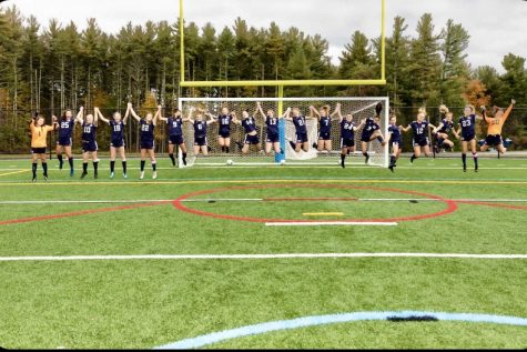 "The girls soccer team jumps for a team photo on HB's new turf field. Through COVID, team bonding time has been scarce, but the girls manage to take advantage of the time they have. ""This has been especially hard because the better we are bonded as a team, the better we play together. However, as a team, we have made a huge effort to work with others during practices to solve this problem."" Said Abbie Ogren ('22)."