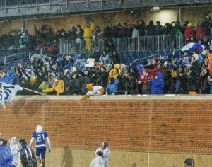 """Marc-Andre Thermitus '21 goes to celebrate with the HB student section after winning the state championship game. """"[The fans] were a huge part of playing that game, just the fact that so many people were willing to sit through that weather to support us really made a difference,"""" said Blake Bergerson '21"""