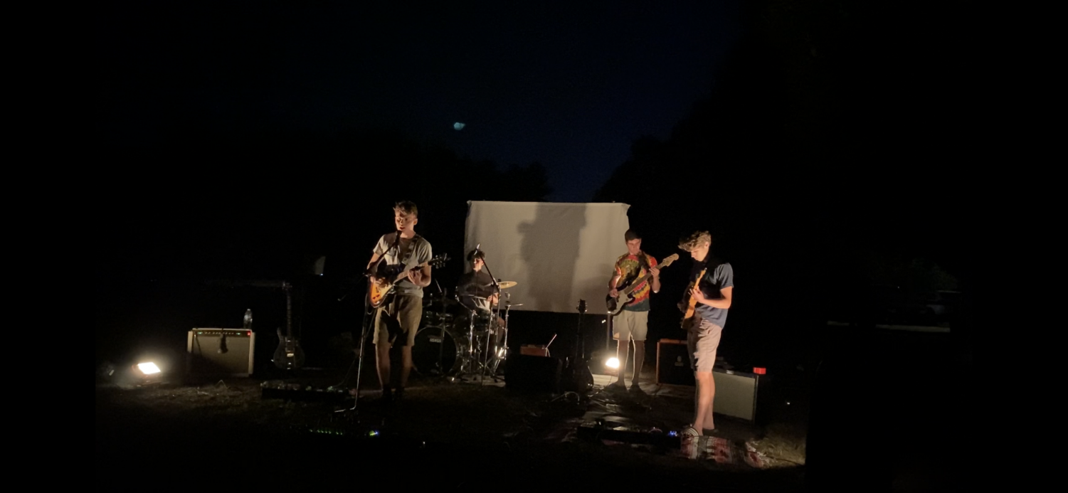 """Hollis-Brookline musicians perform at a socially distanced concert at Nichols Field this summer. """"It was a lot of hard work, but it paid off,"""" said drummer Miles Montgomery, '21 (pictured back-middle). Musicians have been hard-pressed to find opportunities where they can perform due to the COVID-19 pandemic."""