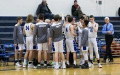 Players gather in a huddle during a timeout in last winter's game vs. Hanover. HB went on to win this game to set them up well for the playoffs.