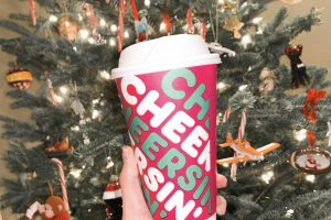 "Dunkin' Donuts holiday cups have the word ""cheersin'"" on the side in order to emphasize the need for more cheer, especially this year. Their holiday spirit has come in the form of three new flavors and a new breakfast sandwich."