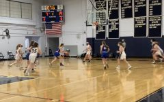 The HB girls win over Milford, 62-14 in their first game. Stapelfeld was the highest scorer with 19 points.
