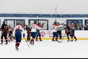 """The team celebrates one of their many wins last year. They had done very well but lost in one of the first games of the playoffs last year. """"We are a family and we all are so passionate about the sport we play. We display hard work and determination and have the true HB spirit."""" said Paul Vachon '22."""
